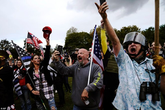Many right-wing members carried flags and Trump 2020 merchandise as they shouted and chanted at the rally