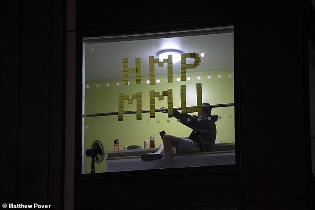 Jess Cook, a parent from Kent, whose son has just started at the institution, said: 'What a waste of £9,000. It is miserable for them.' Pictured, more post-it note messages on halls windows