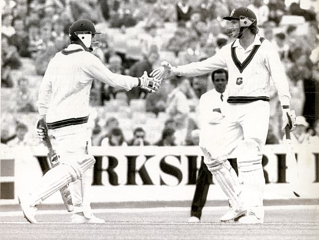 Mark Taylor (left) is congratulated by Dean Jones (right) on making a century during the first match of the 1989 Ashes against England