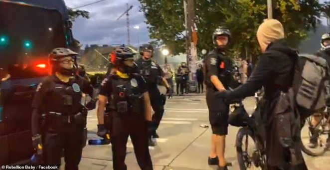 As police moved in on protesters on Capitol Hill they found multiple trash cans and dumpsters had been moved into the street and set ablaze along with other garbage and debris