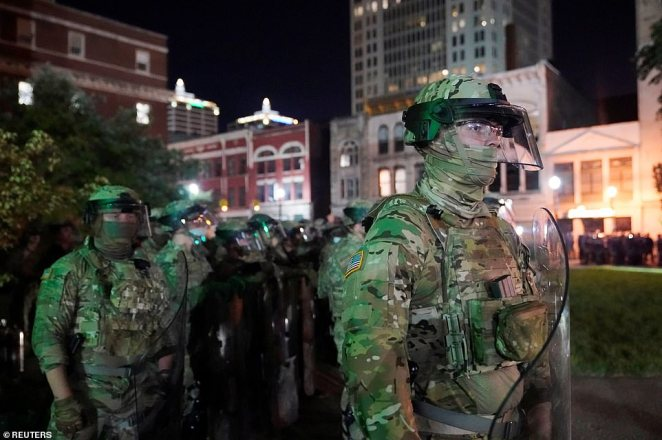 National Guard soldiers prepare to clear a park where demonstrators have assembled in Louisville, Kentucky