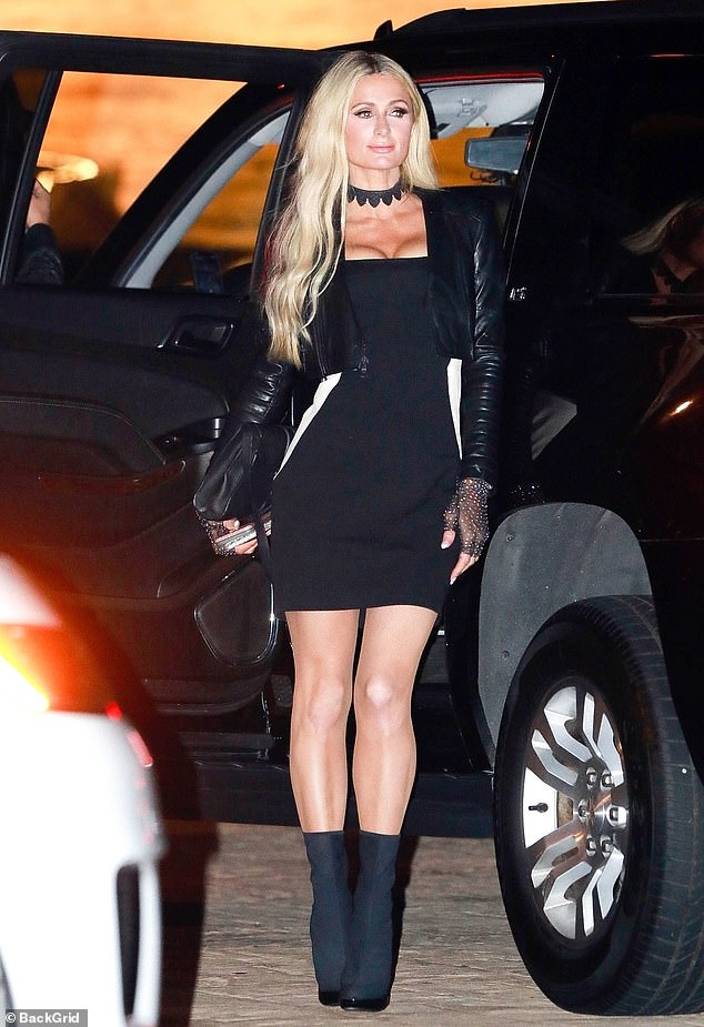 Statuesque: Paris wore heeled black ankle boots, giving an extra lift to her petite 5ft8in frame