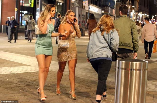 The cold spell was not an issue for these two women as they donned dresses and facemasks for their night out in Leeds