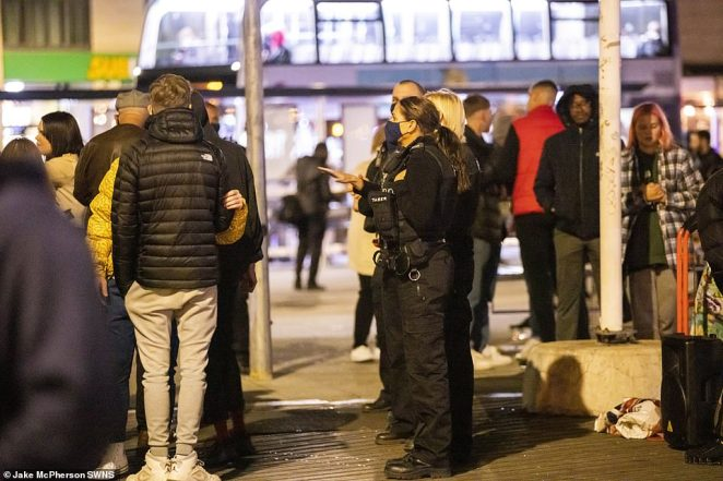 Police like those pictured here attempted to disperse the large crowds that gathered in Bristol past 10pm last night
