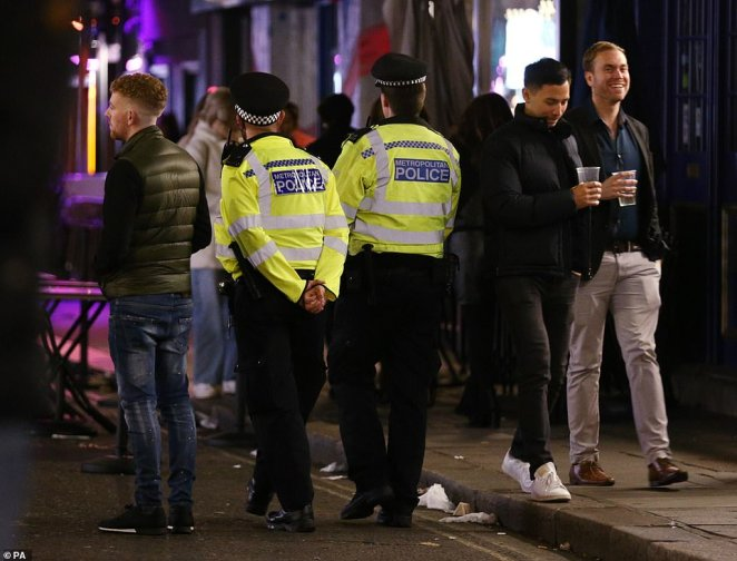 Police officers were on patrol ahead of closing time in Soho, London, after pubs and restaurants were subject to a 10pm curfew to combat the rise in coronavirus cases
