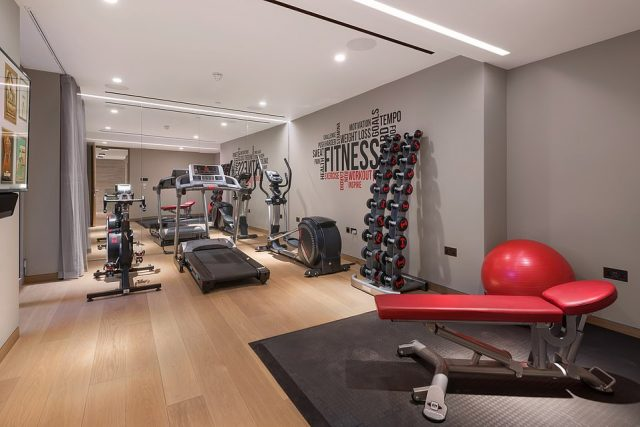 The home features a gymnasium featuring weights, a treadmill, exercise bike and elliptical machine