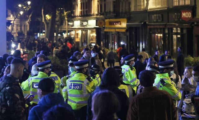 Police were seen in their numbers trying to clear away the crowds of Londoners to took the streets in the city's west end