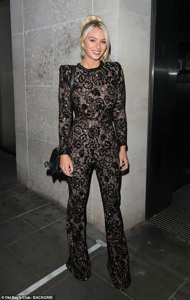 Stunning: Lucielooked sensational in a black sheer jumpsuit with structured shoulders and a floral embroidered print