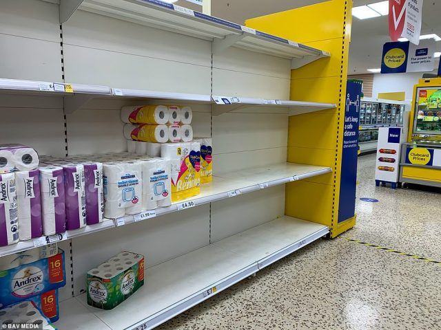 Tesco (pictured: a nearly empty toilet roll shelf at Tesco in Cambridge) has become the latest supermarket to impose rationing on food and household goods, as panic buying returns to the UK amid fears of a second wave of coronavirus