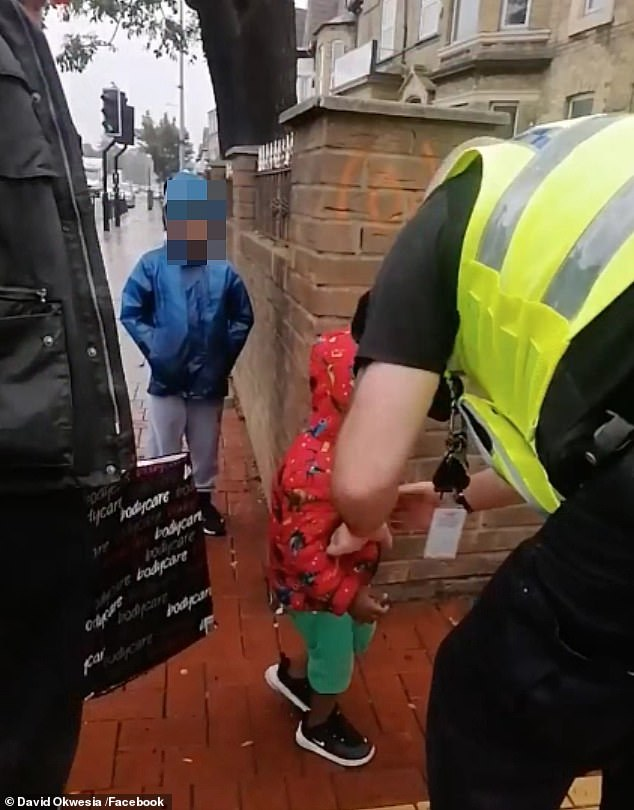 Video footage shows the police arriving on the scene as one policeman tries to talk to the boy, bending down to his level saying: 'We'll find mummy, come on'