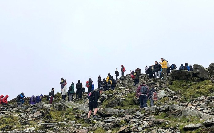 Crowds of walkers flouted social distancing guidelines as they gathered near the top of the mountain over the weekend