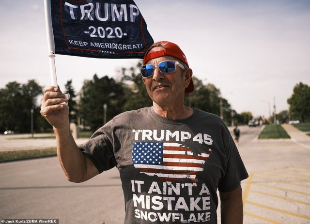 A Donald Trump Supporter is seen wearing a shirt that reads: 'Trump 45. It ain't a mistake snowflake'