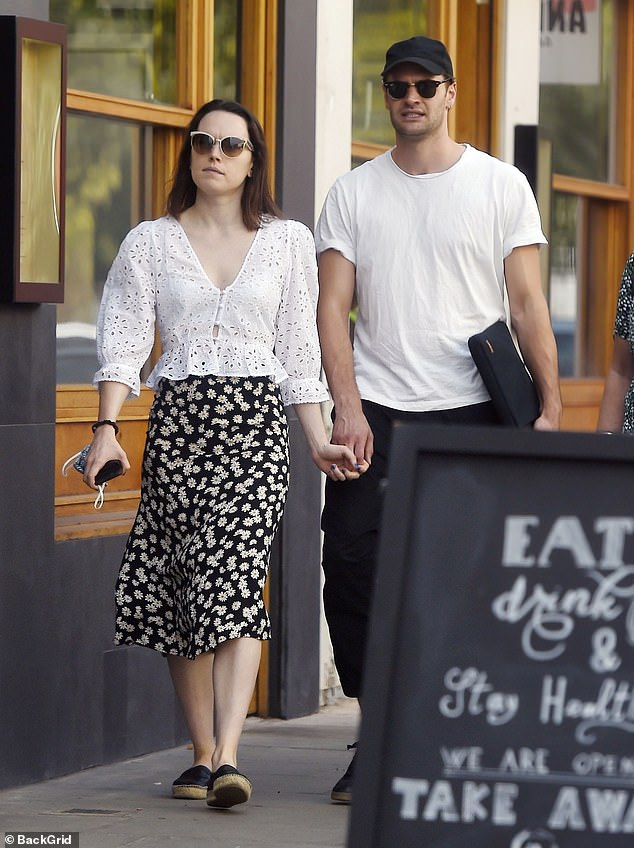 Loved-up: Daisy looked sensational in a floral mid-skirt and white shirt combo