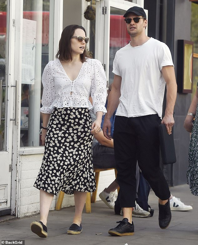 Married? Daisy Ridley continued to fuel engagement speculation as she enjoyed a stroll in London on Sunday with her beau Tom Bateman while they both wore bands on their ring fingers