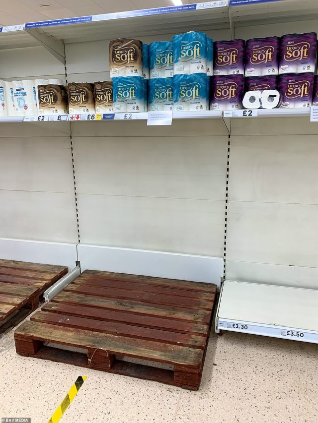 More empty spaces inside the Tesco supermarket in Ely, Cambridgeshire where loo rolls have been limited to one pack per customer amid rise in demand over lockdown fears