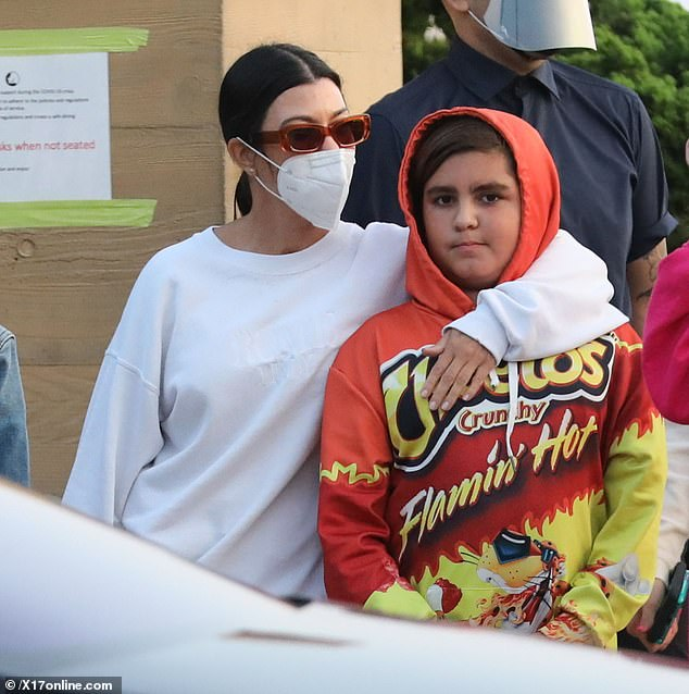 Fun style: Kourtney Kardashian's ten-year-old son Mason expertly stole the spotlight in a daring sweatsuit, which was designed after a bag of Flamin' Hot Cheetos
