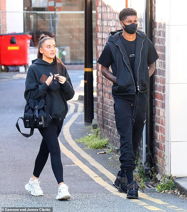 Close: The England star put safety first with a black face mask and tracksuit bottoms as he made his way to a breakfast date with his beau