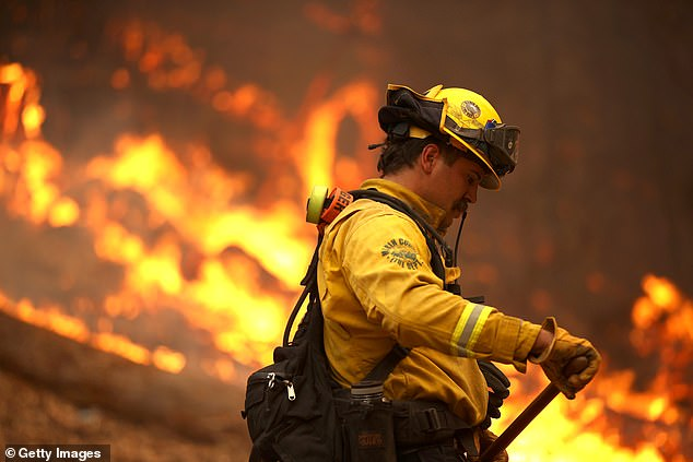 A firefighter is pictured battling the Glass Fire in Calistoga, California, on September 27