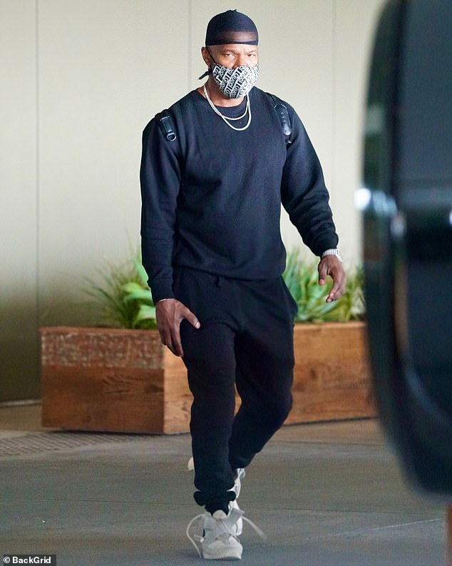 Moving on: Jamie Foxx was spotted holding hands with a mystery woman on Saturday night, while arriving to an upscale hotel in the middle of the night
