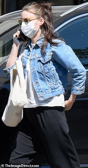 Blue jean baby: She sported a denim jacket and white t-shirt, sans baby bump (pictured in September, 2020)