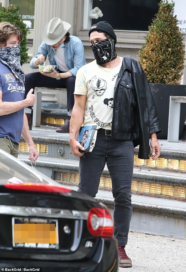 Too cool for school: James wore a cool black leather jacket and indicated he was a Deadhead with is yellow Grateful Dead T-shirt. He also wore black jeans and weathered brown boots