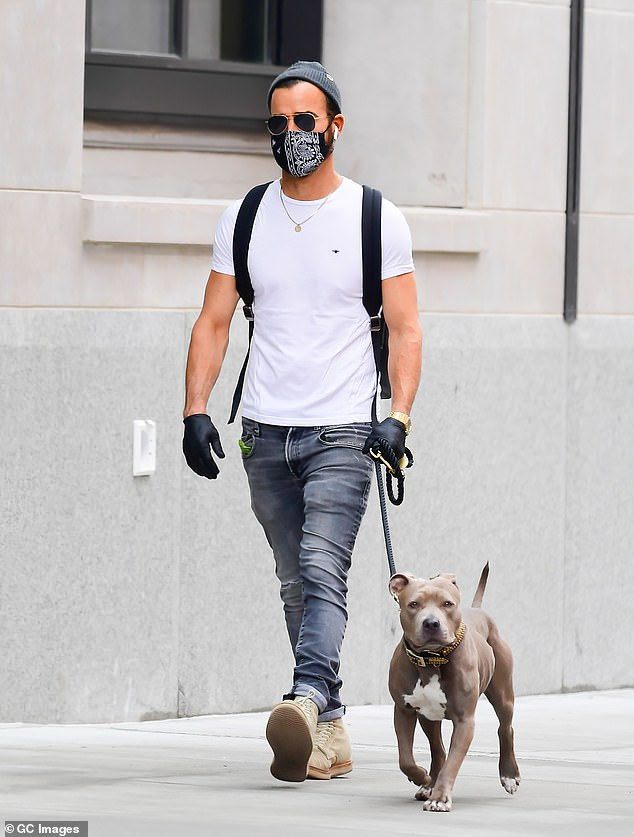Justin's look:Theroux was spotted walking Kuma while wearing a plain white t-shirt with a black backpack strapped to his bag