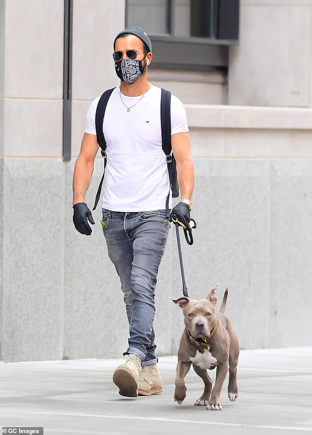 Dog walk:Justin Theroux rocked a stylishly casual look while taking his adorable rescue dog Kuma for a walk