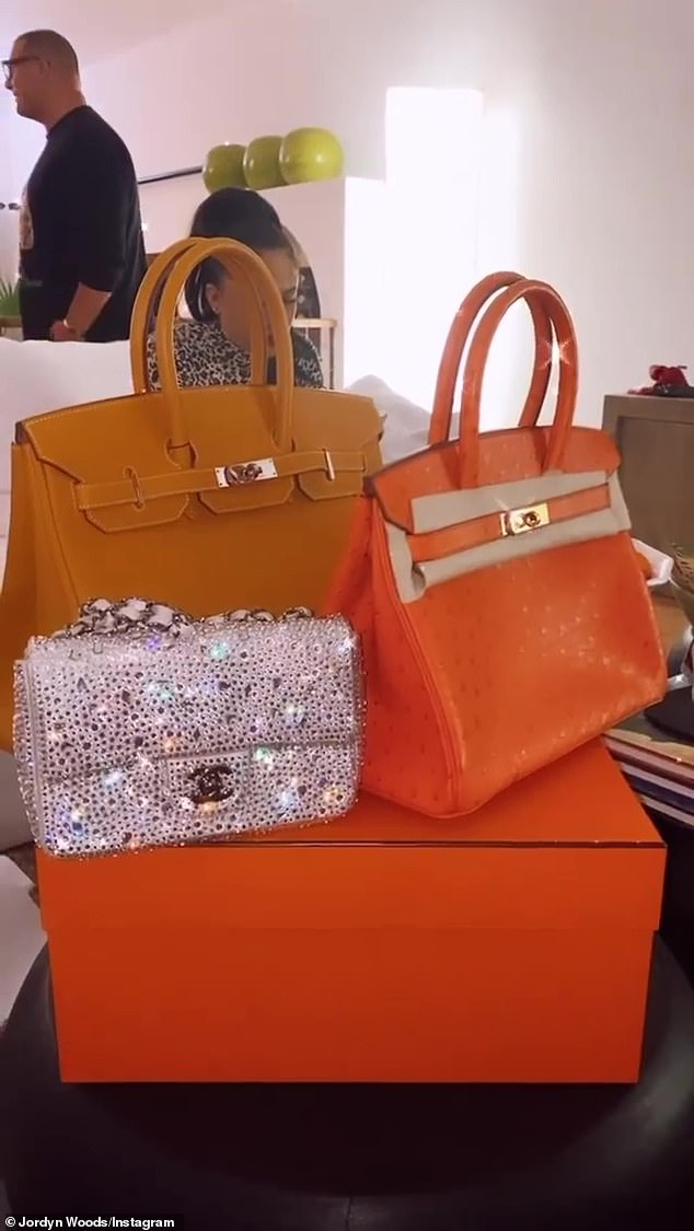 Pricey: Her beau Karl Anthony presented her with multiple handbags, including a Birkin bag and a sparkling Chanel handbag that were worth nearly $50,000