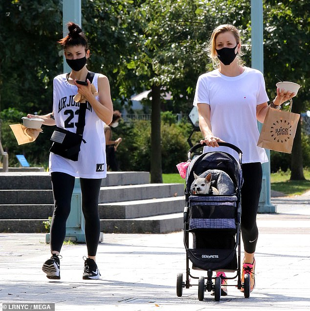 Snacks: The actress, who pushed her beloved Chihuahua in a specially-designed pet stroller, and her sister stopped to pick up some food to during during their casual outing