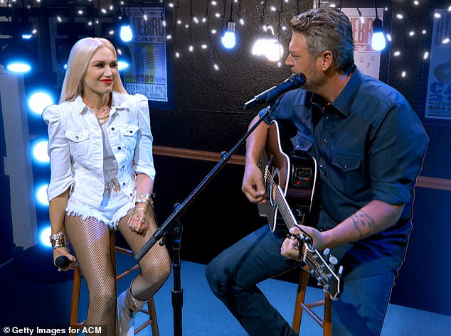 Live performance: Stefani and Shelton performed their duet Happy Anywhere at the Academy of Country Music Awards this month, their first performance together at the awards show