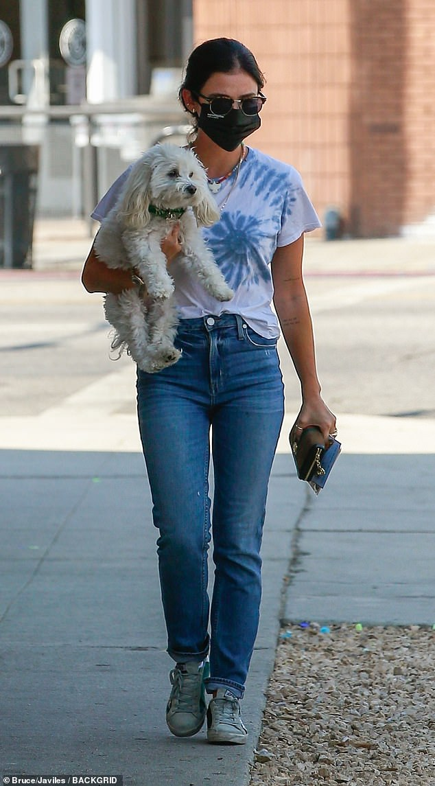 The two of us: Lucy Hale brought along her beloved Maltipoo Elvis as she headed to a mall in LA on Sunday, carrying the pup in one arm and her purse in her other hand
