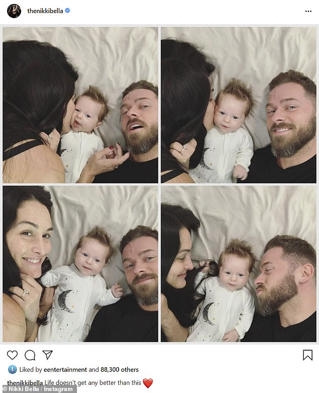 Family photos: Nikki Bella gushed over her baby boy Matteo on Sunday, as she took to Instagram with some family photos of herself and fiancé Artem Chigvintsev giving him smooches, while they lied in bed on either side of him