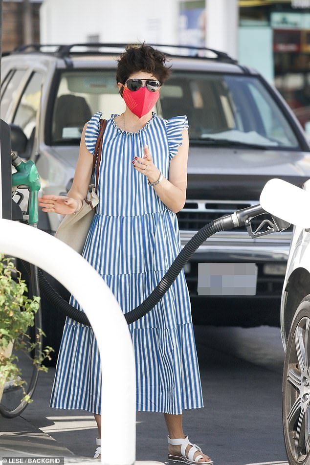 Selma's look:Blair stepped out with a stylish blue and white striped sleeveless maxi dress as she filled up her car