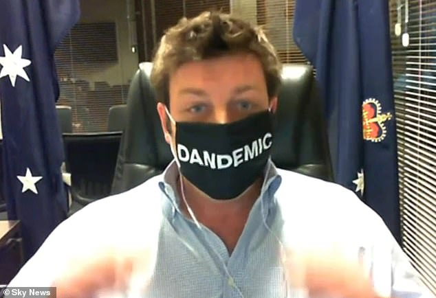 Mr Smith wore a mask with the word 'Dandemic' inscribed during the Sky News interview
