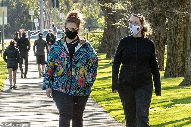 The premier announced $200 fines for anyone not wearing a fitted face mask in public. Pictured: Residents wearing fitted masks in Melbourne