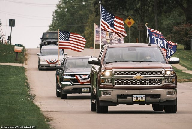 People drive through Des Moines on their way to a motorcade supporting Trump's reelection