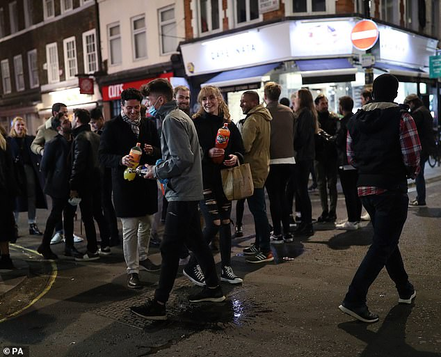 Groups of revellers out in Soho, London last night as Health Secretary Matt Hancock said there had been an 'acceleration of Covid-19 cases across the country'