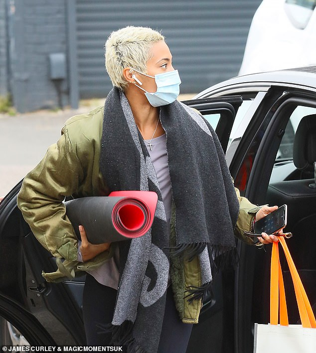 Arrival: Karen exited her car with her hands full of things ahead of rehearsals for the BBC dance show