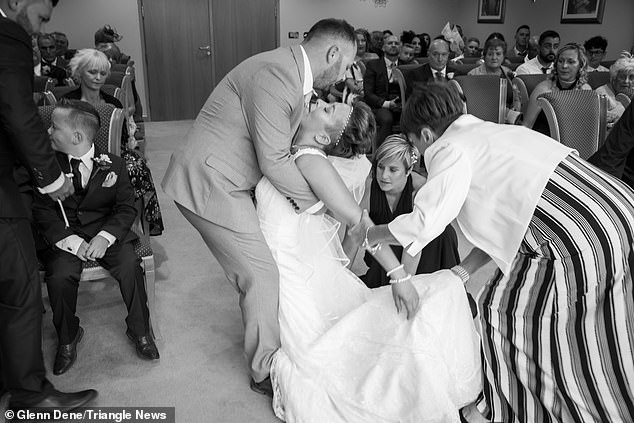 This is the tear-jerking moment a cancer-surviving bride collapsed into her husband's arms after suffering a fit on her big day (pictured)