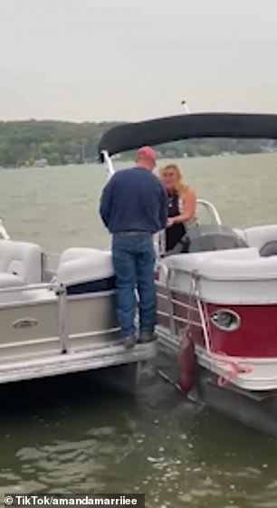 A man's 'fairy-tale' proposal takes an unfortunate turn the groom-to-be is thrown off a boat and into a lake