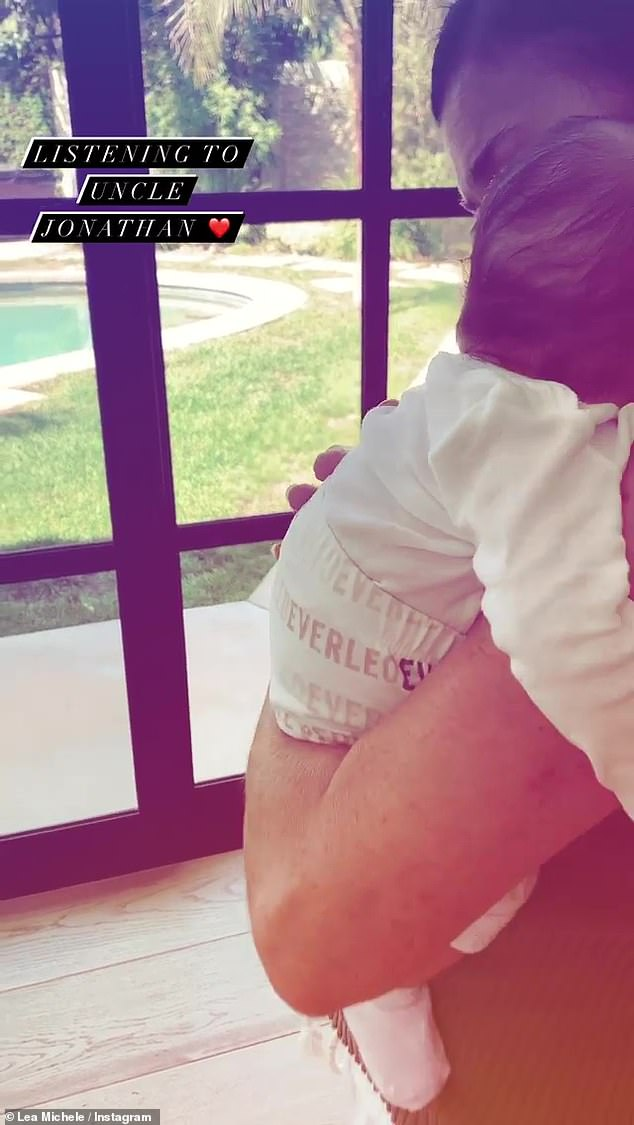 Lullaby: Lea Michele has shared a sweet video to Instagram of her baby son Ever being rocked to sleep, while playing a song sung by Jonathan Groff in the background