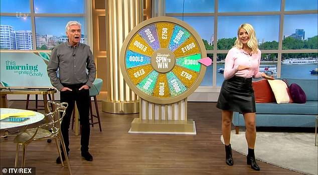 Light, camera, action! The presenter looked stunning in her thigh-high skirt which she teamed with a button-up pink cardigan and heeled ankle boots