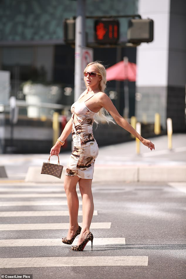 Stopping traffic: The blonde beauty ensured all eyes were on her as she even posed on a crossing on Sunset