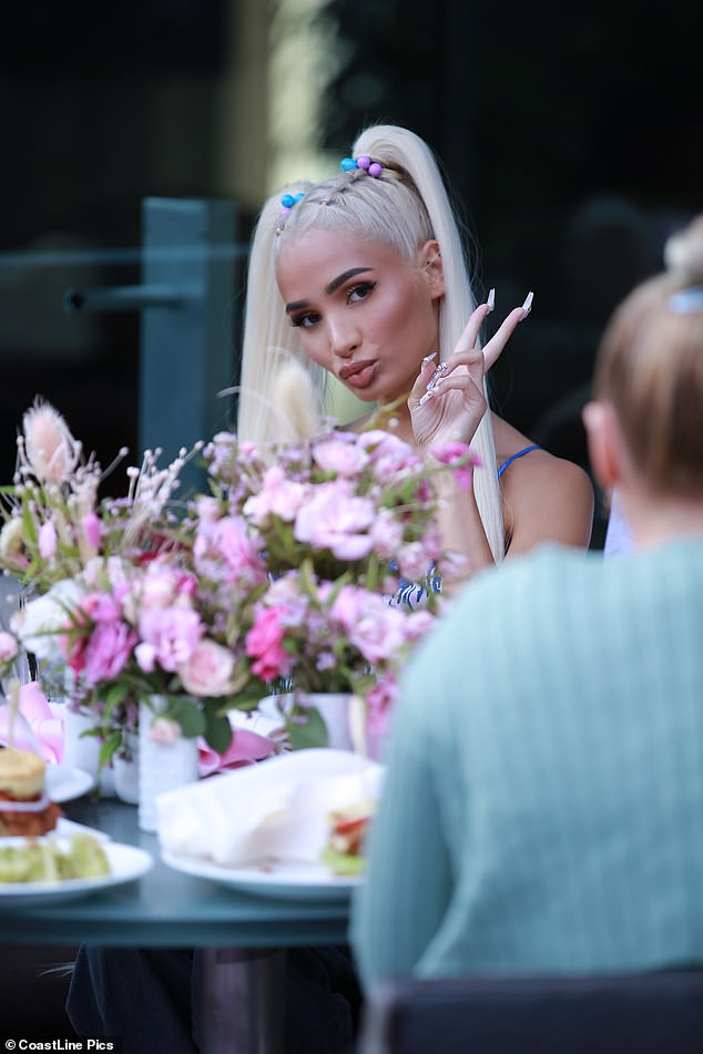 Fun: Pia styled her blonde locks into playful pigtails for the girl's brunch date