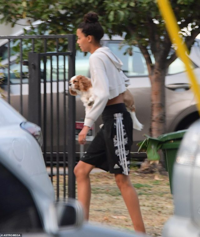 Nickayla changed out of her jeans and kept it casual in shorts and a cropped sweatshirt as she carried a small dog from the property