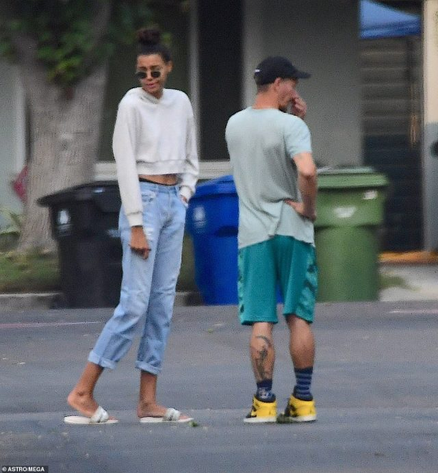 Nickayla wore jeans and a white cropped hoodie to expose her taut midriff while Ryan wore green shorts and t-shirt with sneakers