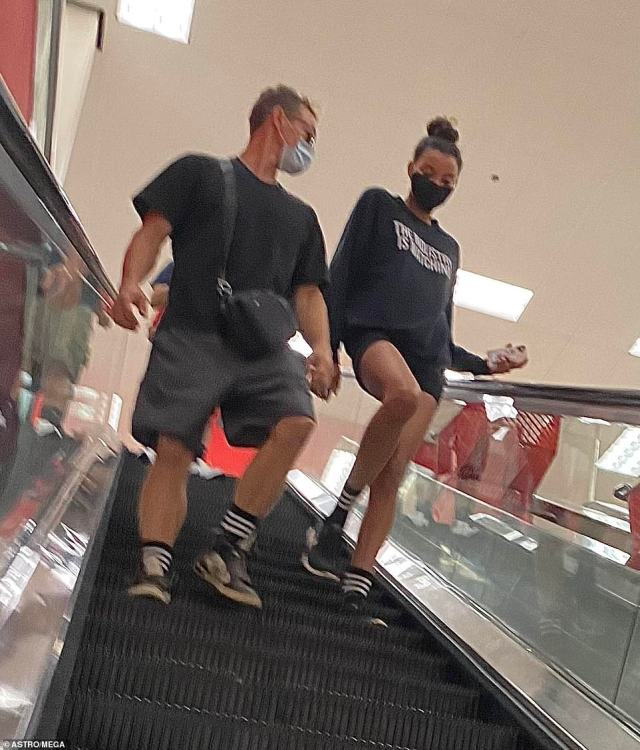 The pair were seen holding hands as they shopped in a local Target store and went down the escalator on September 19