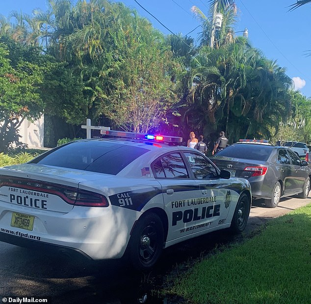The witness, who just happened to be passing by the swank home, said: 'I was on the phone to a friend when I noticed this woman coming towards me with virtually nothing on, just her bathing suit