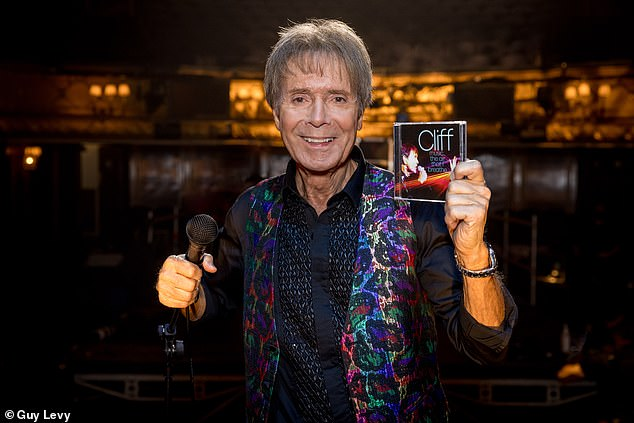 Icon: Cliff Richard looked delighted as he announced his newest album, Music... The Air That I Breathe, which will be released next month in honour of his 80th birthday