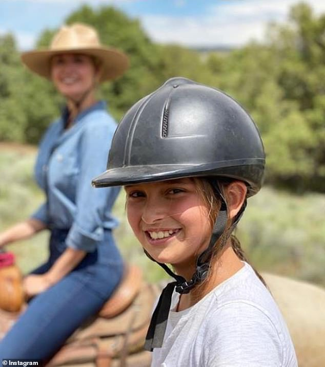 Getaway: One recent image shows Arabella horseback riding with her mom on a family trip